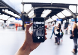visitor taking an image of a train station
